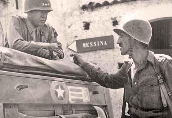 Photo of Lt. Col. Lyle Bernard, CO, 30th Infantry Regiment, discussing military strategy with Lt. Gen. George S. Patton. Near Brolo.